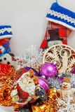 Santa Claus with a snowman. Father Christmas Santa Claus with a snowman in the tinsel. among Christmas balls and Christmas decoration Stock Images