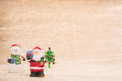 Santa Claus and snowman with fir tree. On illuminated background Royalty Free Stock Photos