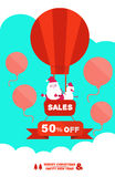 Santa Claus and snowman flying in a hot air balloon with Sales banner. Royalty Free Stock Image