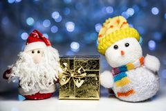 Santa Claus and Snowman with gift box Stock Photography