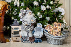 Santa Claus and snowman with gifts in the New Year's holiday Royalty Free Stock Photography