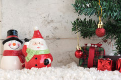 Santa claus and snowman on the snow with christmas tree Stock Photography