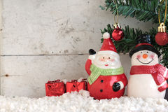 Santa claus and snowman on the snow with christmas tree Stock Photos