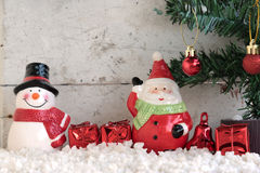 Santa claus and snowman on the snow with christmas tree Stock Images