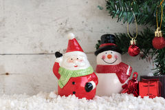Santa claus and snowman on the snow with christmas tree Royalty Free Stock Photography