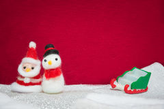Santa claus, snowman wool doll and greed sled on snow set up wit Stock Image