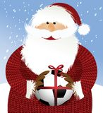 Santa Claus with soccer ball Stock Images