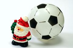 Santa Claus and the soccer ball on white Stock Photos