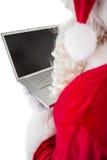 Santa Claus som använder hans bärbar dator Arkivfoton