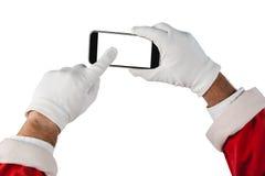 Santa Claus som använder mobiltelefonen Royaltyfria Bilder