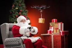 Santa Claus som använder surret Arkivbilder