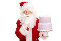 Santa Claus som bär en stor kaka Royaltyfria Foton