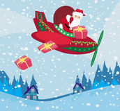 Santa Claus som flyger över stad Arkivfoton