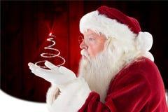Santa Claus som gör en gest mot digitalt frambragd bakgrund Royaltyfria Foton