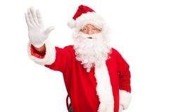 Santa Claus som gör ett stopp att göra en gest Arkivfoto