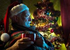 Santa Claus som hemma kopplar av Royaltyfri Fotografi