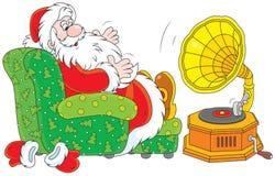 Santa Claus som lyssnar till musik Royaltyfri Bild