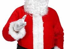 Santa Claus som pekar något med hans finger Arkivbild