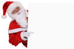Santa Claus som pekar på jul på det tomma banret med copyspace Royaltyfria Bilder