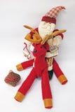 Santa Claus som rider en ren Royaltyfria Bilder