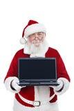 Santa Claus som rymmer den moderna bärbar dator Royaltyfria Foton