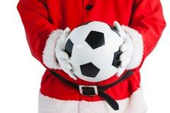 Santa Claus som rymmer en fotboll Royaltyfri Foto
