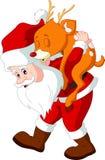 Santa Claus som rymmer en hjort Arkivfoton
