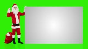 Santa Claus som skakar klockan som framlägger ett vitt ark, grön skärm, materiellängd i fot räknat