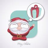 Santa Claus som tinking en gåva Arkivfoton