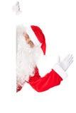 Santa Claus som vinkar med det tomma tecknet Fotografering för Bildbyråer