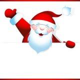 Santa Claus sostiene la bandera en blanco Imagenes de archivo