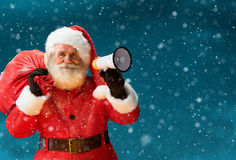 Santa Claus speaking in megaphone. Royalty Free Stock Images
