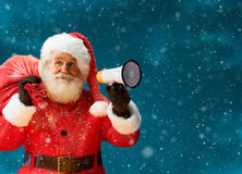 Santa Claus speaking in megaphone. Stock Photography