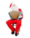 Santa Claus speelt de harmonika stock foto's