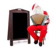 Santa Claus speelt de harmonika royalty-vrije stock fotografie