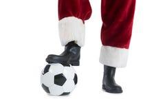 Santa Claus spelar fotboll Fotografering för Bildbyråer