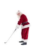 Santa Claus spelar golf Arkivbild