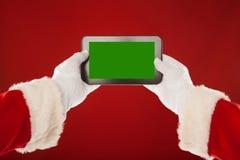 Santa Claus sta tenendo il piatto con un verde Fotografie Stock