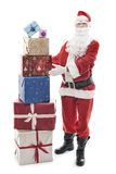 Santa Claus with stacked christmas presents Stock Image