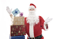 Santa Claus with stacked christmas presents Royalty Free Stock Photo