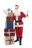 Santa Claus with stacked christmas presents Royalty Free Stock Photos