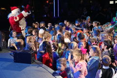 Santa Claus on stage. Children's Christmas party ( the new year holiday tree ) in the club Atmosphere 03/01/2012. St. Petersburg, Russia, Europe. Lucky man in Stock Photography