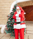 Santa Claus Standing Arms Crossed Outside House Stock Photo