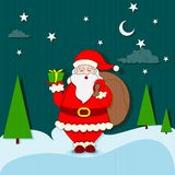 Santa Claus standing with Christmas gift Stock Image