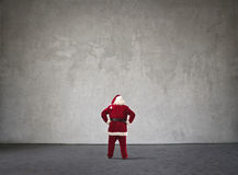 Santa Claus standing in front of a wall Stock Photo