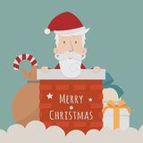 Santa Claus standing gift boxes falling down around him Royalty Free Stock Image