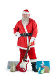 Santa claus standing with guitar and various gift Stock Photo