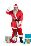 Santa claus standing with guitar and various gift Royalty Free Stock Photography