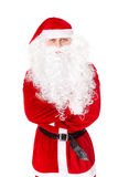 Santa Claus standing with hands folded against Royalty Free Stock Image