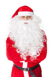 Santa Claus standing with hands folded against Stock Photos